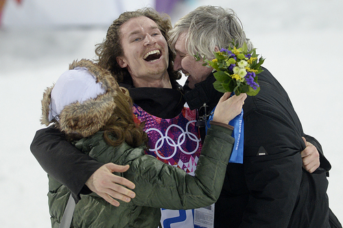 ROSA KHUTOR, RUSSIA - FEBRUARY 11: Gold medalist Iouri Podladchikov of Switzerland hugs his parents Yurii and Valentina after the men's snowboard halfpipe final. Podladchikov knocked off two-time defending gold medalist Shaun White as the event's top placer. Sochi 2014 Winter Olympics on Tuesday, February 11, 2014. (Photo by AAron Ontiveroz/The Denver Post)