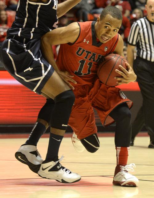 Rick Egan  | The Salt Lake Tribune   Utah Utes guard Brandon Taylor (11) tries to get by Brigham Young Cougars guard Anson Winder (20), in basketball action, at the Huntsman Center, Saturday, December 14, 2013.