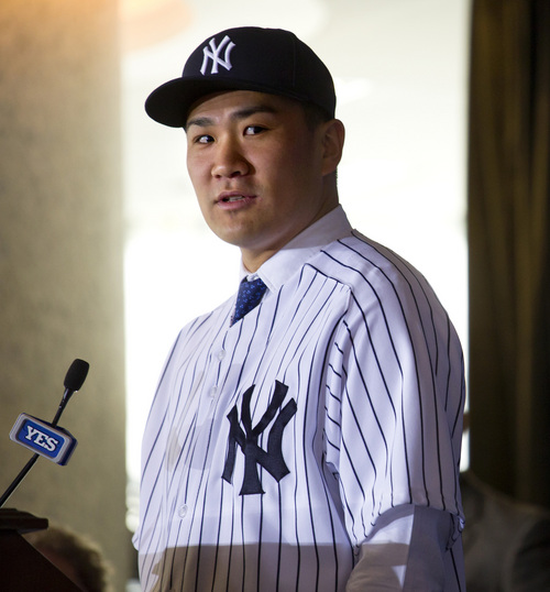 New York Yankees' pitcher Masahiro Tanaka answers a question after he was introduced to the media at Yankee Stadium in New York Tuesday, Feb. 11, 2014.  (AP Photo/Craig Ruttle)