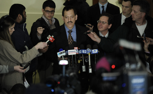 Attorney for the College Athletes Players Union John Adam speaks to the media after a National Labor Relations Board hearing on the request by Northwestern University football players  to unionize in Chicago, Wednesday, Feb. 11, 2014. (AP Photo/Paul Beaty)