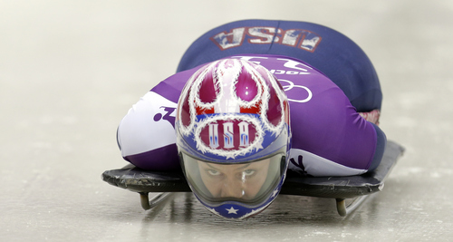 Noelle Pikus-Pace of the United States starts a training run for the women's skeleton during the 2014 Winter Olympics, Monday, Feb. 10, 2014, in Krasnaya Polyana, Russia. (AP Photo/Natacha Pisarenko)