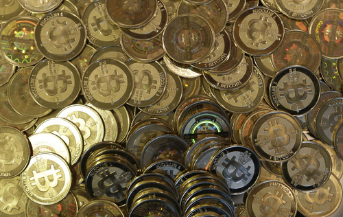FILE - This April 3, 2013 file photo shows bitcoin tokens in Sandy, Utah.  (AP Photo/Rick Bowmer, File)