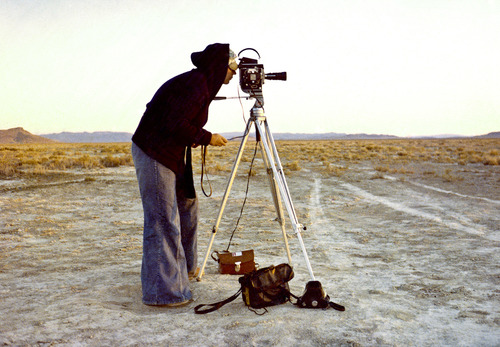 """Nancy Holt shooting the 1978 film """"Sun Tunnels,"""" capturing her installation work in the ghost town of Lucin, Utah. Courtesy Lee Deffebach  