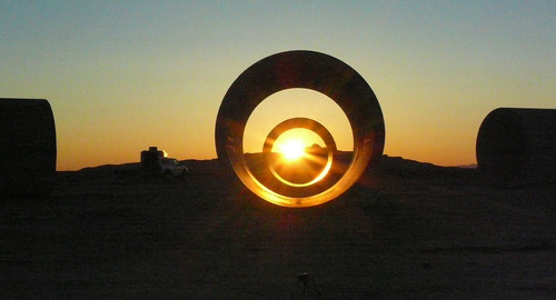 Tribune file photo Sun rises about 6 a.m. in the Sun Tunnels near Lucin, Utah on the Summer Solstice.  Artist Nancy Holt created the Sun Tunnels, four concrete culverts arranged to align with the sun on Summer Solstice. Holt died Saturday in Manhattan at the age of 75.