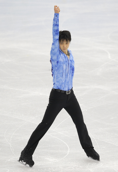Yuzuru Hanyu of Japan competes in the men's short program figure skating competition at the Iceberg Skating Palace at the 2014 Winter Olympics, Thursday, Feb. 13, 2014, in Sochi, Russia. (AP Photo/Vadim Ghirda)