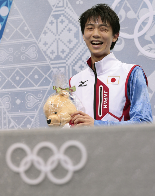 Yuzuru Hanyu of Japan waits for his results after competing in the men's short program figure skating competition at the Iceberg Skating Palace during the 2014 Winter Olympics, Thursday, Feb. 13, 2014, in Sochi, Russia. (AP Photo/Ivan Sekretarev)