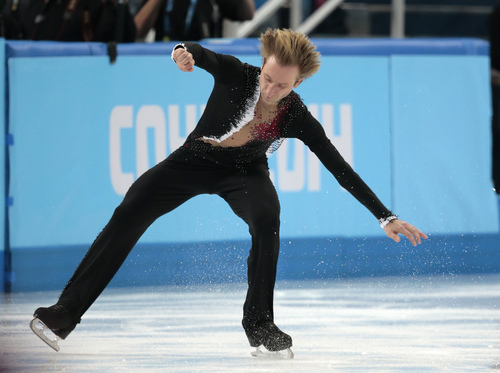 Evgeni Plushenko of Russia skates on the ice prior to pulling out of the men's short program figure skating competition due to illness at the Iceberg Skating Palace during the 2014 Winter Olympics, Thursday, Feb. 13, 2014, in Sochi, Russia. (AP Photo/Ivan Sekretarev)