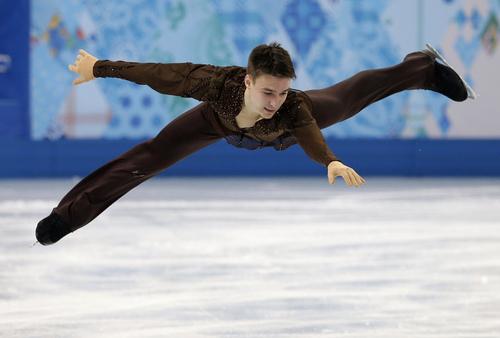 Viktor Romanenkov of Estonia competes in the men's short program figure skating competition at the Iceberg Skating Palace during the 2014 Winter Olympics, Thursday, Feb. 13, 2014, in Sochi, Russia. (AP Photo/Darron Cummings)