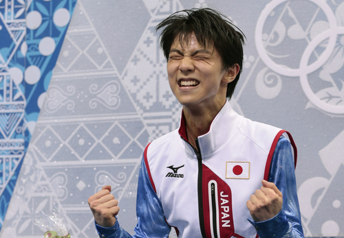 Yuzuru Hanyu of Japan reacts as he receives his results after competing in the men's short program figure skating competition at the Iceberg Skating Palace during the 2014 Winter Olympics, Thursday, Feb. 13, 2014, in Sochi, Russia. (AP Photo/Ivan Sekretarev)