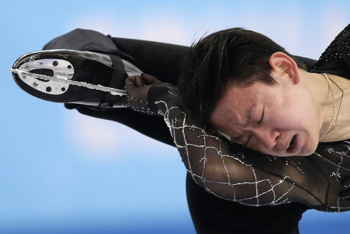 Denis Ten of Kazakhstan competes in the men's short program figure skating competition at the Iceberg Skating Palace during the 2014 Winter Olympics, Thursday, Feb. 13, 2014, in Sochi, Russia. (AP Photo/Bernat Armangue)