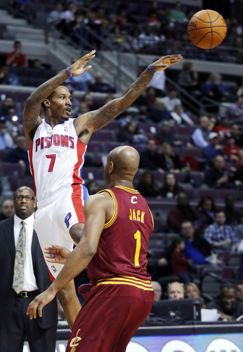Detroit Pistons guard Brandon Jennings (7) passes the ball against the defense from Cleveland Cavaliers guard Jarrett Jack (1) during the second half of an NBA basketball game Wednesday, Feb. 12, 2014, in Auburn Hills, Mich. (AP Photo/Duane Burleson)