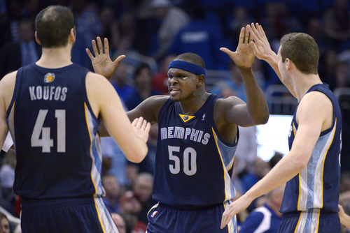 Memphis Grizzlies forward Zach Randolph (50) is congratulated by center Kosta Koufos (41) and forward Jon Leuer, right, after scoring a basket late in the second half of an NBA basketball game against the Orlando Magic in Orlando, Fla., Wednesday, Feb. 12, 2014. The Grizzlies won 86-81. (AP Photo/Phelan M. Ebenhack)