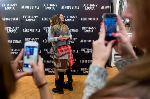 Trent Nelson  |  The Salt Lake Tribune A fan gets a hug from YouTube star Bethany Mota, at the Aeropostale store in Fashion Place Mall in Murray where she opened a new line of clothing Thursday February 13, 2014.