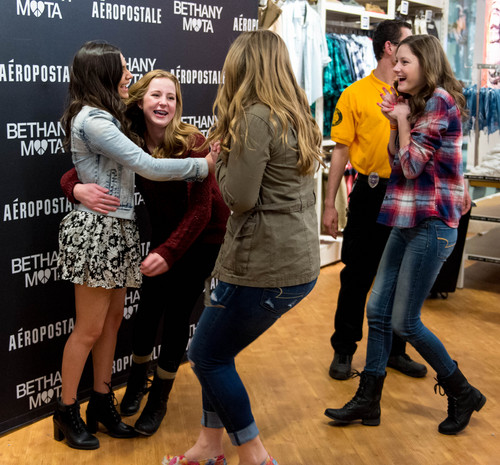 Trent Nelson  |  The Salt Lake Tribune Kaylie Ross, Maren Pilcher and Jessica Brroks rush in to meet YouTube star Bethany Mota, at the Aeropostale store in Fashion Place Mall in Murray where she opened a new line of clothing Thursday February 13, 2014.