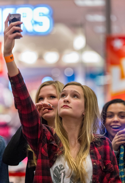 Trent Nelson  |  The Salt Lake Tribune Gracie Overturf holds her phone up for a photo of YouTube star Bethany Mota at the Aeropostale store in Fashion Place Mall in Murray where she opened a new line of clothing Thursday February 13, 2014.