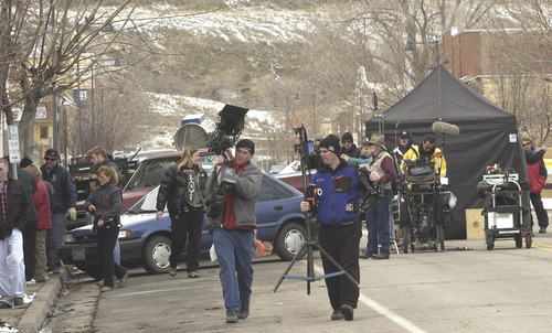 Al Hartmann | Tribune File Photo Touched by an Angel's crew sets up for their last full day of filming the series on Main Street in downtown Magna.    3/4/03