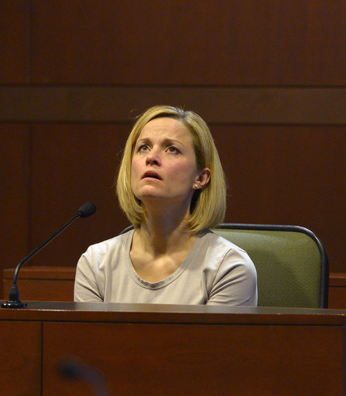 "Leah Hogsten  |  The Salt Lake Tribune Dea Millerberg testifies against her husband, Eric Millerberg, Wednesday, February 12, 2014 in 2nd District Court. Eric Millerberg is accused in the 2011 drug-related death of his children's 16-year-old baby sitter. Millerberg, 38, of North Ogden, is charged with first-degree felony child-abuse homicide in the September 2011 death of Alexis ""Lexi"" Rasmussen. He also is charged with felony counts of obstructing justice, desecrating a body and having unlawful sexual activity with a minor."