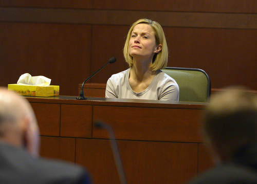 "Leah Hogsten  |  The Salt Lake Tribune Dea Millerberg testifies against her husband, Eric Millerberg, Wednesday, February 12, 2014 in 2nd District Court. Eric Millerberg is accused in the 2011 drug-related death of his childrenís 16-year-old baby sitter. Millerberg, 38, of North Ogden, is charged with first-degree felony child-abuse homicide in the September 2011 death of Alexis ""Lexi"" Rasmussen. He also is charged with felony counts of obstructing justice, desecrating a body and having unlawful sexual activity with a minor."