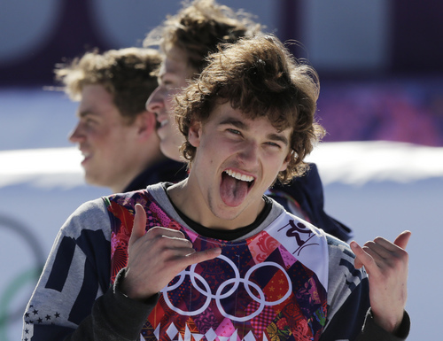 Nicholas Goepper of the United States celebrates his bronze medal in the men's ski slope style, before a flower ceremony at the Rosa Khutor Extreme Park, at the 2014 Winter Olympics, Thursday, Feb. 13, 2014, in Krasnaya Polyana, Russia. Behind him are teammates Gus Kenworthy, left, who won silver, and Joss Christensen, who won gold.  (AP Photo/Andy Wong)