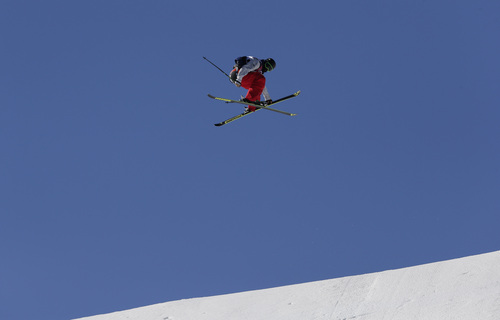 Men's ski slopestyle gold medal winner Joss Christensen of the United States takes a jump on his last run, at the Rosa Khutor Extreme Park,  at the 2014 Winter Olympics, Thursday, Feb. 13, 2014, in Krasnaya Polyana, Russia.  (AP Photo/Andy Wong)