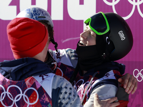 Gold medal winner Joss Christensen of the United States, right, celebrates with compatriots Gus Kenworthy, left, who won silver, and Nicholas Goepper, (obscured), who won bronze,  after the men's ski slopestyle final at the Rosa Khutor Extreme Park, at the 2014 Winter Olympics, Thursday, Feb. 13, 2014, in Krasnaya Polyana, Russia. (AP Photo/Gero Breloer)