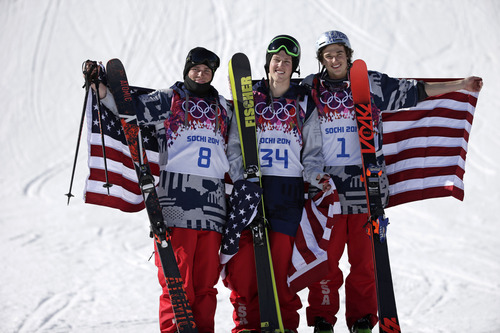 Men's ski slopestyle medalists from the United States Gus Kenworthy, left, silver, Joss Christensen, center, gold, and Nicholas Goepper, bronze, right, pose for photographers on the podium at the Rosa Khutor Extreme Park, at the 2014 Winter Olympics, Thursday, Feb. 13, 2014, in Krasnaya Polyana, Russia.(AP Photo/Gero Breloer)