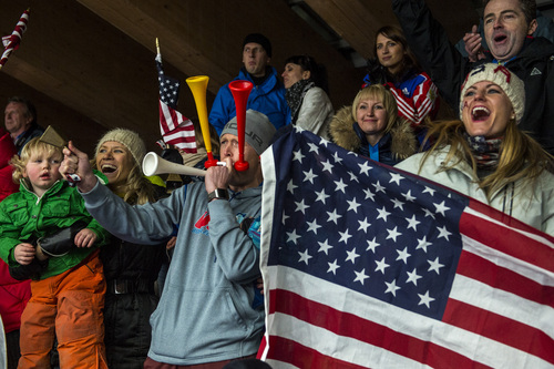 KRASNAYA POLYANA, RUSSIA  - JANUARY 14: Noelle Pikus-Pace's family; son Traycen, 2, sister Amanda, husband Janson, and daughter Lacee, 6, cheer as she crosses the finish line in the women's skeleton competition at Sanki Sliding Center during the 2014 Sochi Olympics Friday February 14, 2014. Pikus-Pace finished with a time of 3:53.86. (Photo by Chris Detrick/The Salt Lake Tribune)