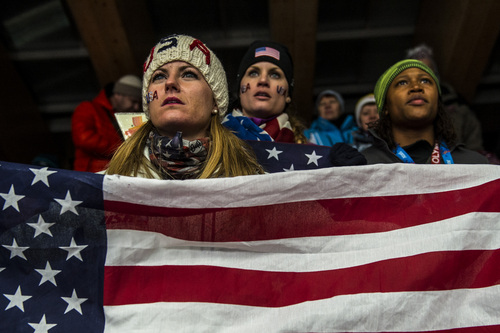 KRASNAYA POLYANA, RUSSIA  - JANUARY 14: Skeleton athletes Blair Tomten, Morgan Tracey and bobsled athlete Lauryn Williams cheer on fellow American Katie Uehlander, of Breckenridge, Colo., as she competes during the women's skeleton competition at Sanki Sliding Center during the 2014 Sochi Olympics Friday February 14, 2014. Uehlander finished in fourth place with a time of 3:54.34. (Photo by Chris Detrick/The Salt Lake Tribune)