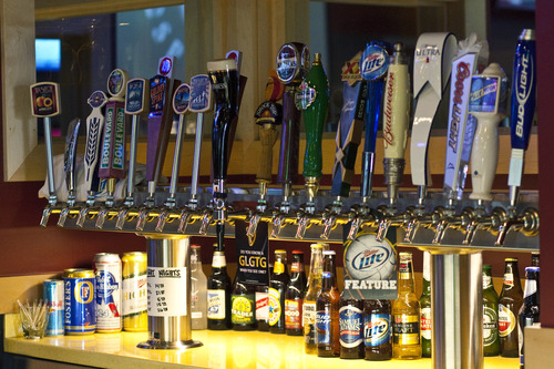 Chris Detrick  |  Tribune File A proposed bill may require breathalyzers in Utah bars and will let patrons, if they choose, test their blood-alcohol levels before driving a car. Beer taps are seen in this file photo at Buffalo Wild Wing's Lehi restaurant.