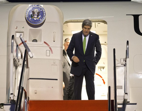 Secretary of State John Kerry steps off his plane after arriving at Halim Air Field on Saturday, Feb. 15, 2014, in Jakarta, Indonesia. (AP Photo/Evan Vucci, Pool)