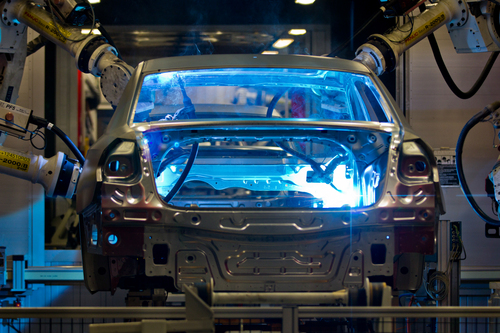 FILE - In this July 31, 2012, file photo, robotic arms weld the interior of a Volkswagen Passat sedan at the German automaker's plant in Chattanooga, Tenn.. A three-day election on whether workers will be represented by the United Auto Workers union concludes on Friday, Feb. 14, 2014. (AP Photo/Erik Schelzig, file)