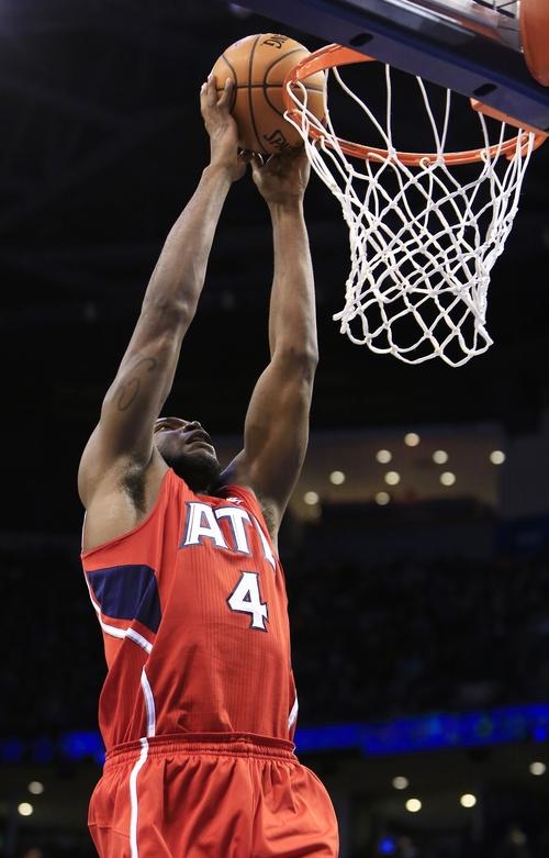 Atlanta Hawks forward Paul Millsap (4) dunks during the second quarter of an NBA basketball game against the Oklahoma City Thunder, Monday, Jan. 27, 2014, in Oklahoma City. (AP Photo/Alonzo Adams)