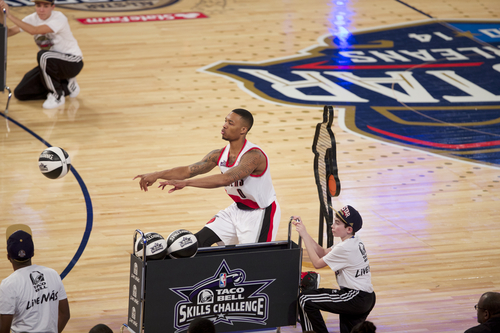 Portland Trail Blazers point guard Damian Lillard (0) participates in the skills competition at the NBA All Star basketball game on Saturday, Feb. 15, 2014, in New Orleans. (AP Photo/The Oregonian, Bruce Ely) MAGAZINES OUT; TV OUT; LOCAL TV OUT; LOCAL INTERNET OUT; THE MERCURY OUT; WILLAMETTE WEEK OUT; PAMPLIN MEDIA GROUP OUT