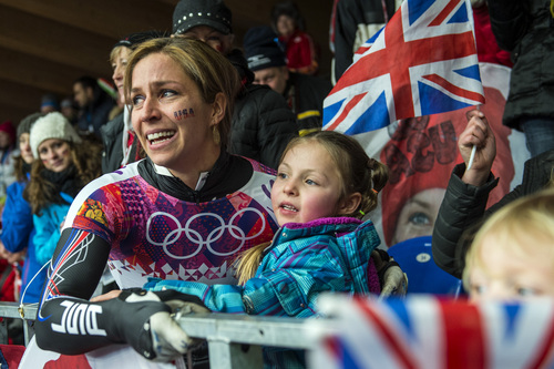 KRASNAYA POLYANA, RUSSIA  - JANUARY 14: Noelle Pikus-Pace celebrates with her daughter Lacee, 6, after winning the silver medal in the women's skeleton competition at Sanki Sliding Center during the 2014 Sochi Olympics Friday February 14, 2014. Pikus-Pace finished with a time of 3:53.86. (Photo by Chris Detrick/The Salt Lake Tribune)