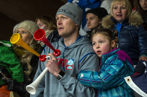 KRASNAYA POLYANA, RUSSIA  - JANUARY 14: Noelle Pikus-Pace's husband Janson and daughter Lacee, 6, watch her compete in the women's skeleton competition at Sanki Sliding Center during the 2014 Sochi Olympics Friday February 14, 2014. Pikus-Pace finished with a time of 3:53.86. (Photo by Chris Detrick/The Salt Lake Tribune)