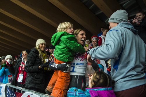 KRASNAYA POLYANA, RUSSIA  - JANUARY 14: Noelle Pikus-Pace celebrates with her family; son Traycen, 2, daughter Lacee, 6, husband Janson, right, after winning the silver medal in the women's skeleton competition at Sanki Sliding Center during the 2014 Sochi Olympics Friday February 14, 2014. Pikus-Pace finished with a time of 3:53.86. (Photo by Chris Detrick/The Salt Lake Tribune)