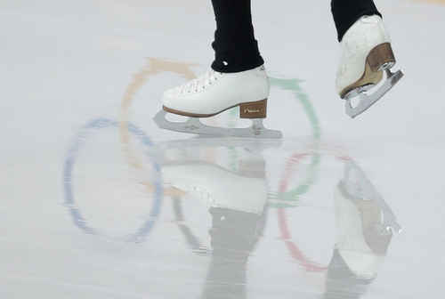 Yuna Kim of South Korea skates at the figure skating practice rink at the 2014 Winter Olympics, Friday, Feb. 14, 2014, in Sochi, Russia. (AP Photo/Ivan Sekretarev)