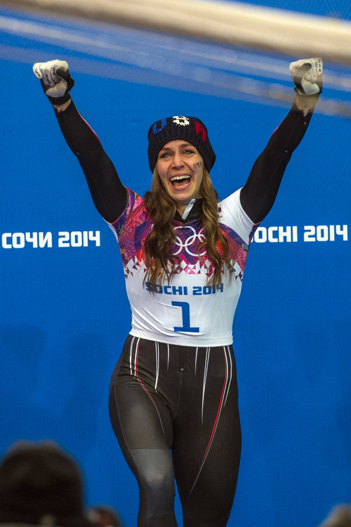 KRASNAYA POLYANA, RUSSIA  - JANUARY 14: Noelle Pikus-Pace celebrates after winning the silver medal in the women's skeleton competition at Sanki Sliding Center during the 2014 Sochi Olympics Friday February 14, 2014. Pikus-Pace finished with a time of 3:53.86. (Photo by Chris Detrick/The Salt Lake Tribune)
