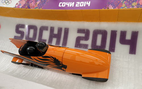 The team from the Netherlands NED-1, piloted by Esme Kamphuis, takes a curve during a training run for the women's two-man bobsled at the 2014 Winter Olympics, Friday, Feb. 14, 2014, in Krasnaya Polyana, Russia. (AP Photo/Michael Sohn)