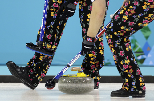 Norway wears pants with a rose painting  design during men's curling competition against Canada at the 2014 Winter Olympics, Friday, Feb. 14, 2014, in Sochi, Russia. (AP Photo/Robert F. Bukaty)