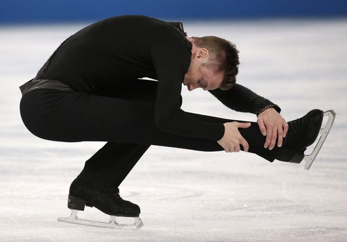 Jeremy Abbott of the United States competes in the men's free skate figure skating final at the Iceberg Skating Palace during the 2014 Winter Olympics, Friday, Feb. 14, 2014, in Sochi, Russia. (AP Photo/Bernat Armangue)