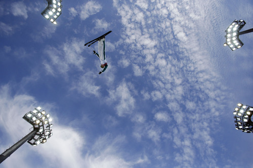 Australia's Lydia Lassila jumps during women's freestyle skiing aerials training at the Rosa Khutor Extreme Park, at the 2014 Winter Olympics, Friday, Feb. 14, 2014, in Krasnaya Polyana, Russia. (AP Photo/Greg Baker)
