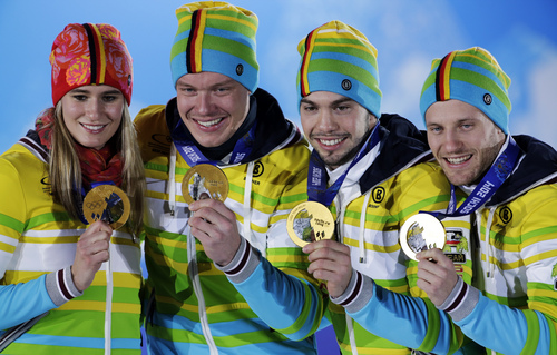 Luge team relay gold medalists from Germany pose with their medals at the 2014 Winter Olympics, Friday, Feb. 14, 2014, in Sochi, Russia. (AP Photo/David J. Phillip )