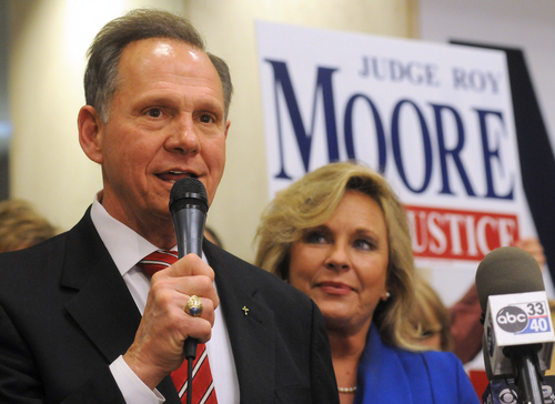 FILE - In this Tuesday, Nov. 6, 2012 file photo, Roy Moore, candidate for Alabama Supreme Court chief justice, speaks to the audience as wife Kayla looks on at his election party in Montgomery, Ala., on election night. Chief Justice Moore, known for fighting to display the Ten Commandments in a judicial building, has written to all 50 governors urging them to support a federal constitutional amendment defining marriage as between only a man and a woman. (AP Photo/David Bundy, File)