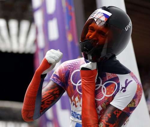 Alexander Tretiakov of Russia celebrates in the finish area after he won the gold medal during the men's skeleton competition at the 2014 Winter Olympics, Saturday, Feb. 15, 2014, in Krasnaya Polyana, Russia. (AP Photo/Natacha Pisarenko)