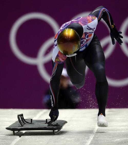 John Daly of the United States struggles to get his sled in the start grooves on his final run during the men's skeleton competition at the 2014 Winter Olympics, Saturday, Feb. 15, 2014, in Krasnaya Polyana, Russia. (AP Photo/Dita Alangkara)