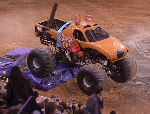 "Leah Hogsten  |  The Salt Lake Tribune  Monster truck ""Scooby-Doo"" roars throughout EnergySolutions Arena, Saturday, Feb. 15, 2014, during ""Monster Jam,"" going on through Sunday."