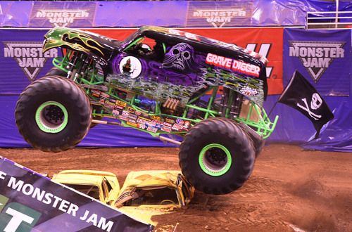 "Leah Hogsten  |  The Salt Lake Tribune Monster truck ""Grave Digger"" roars throughout EnergySolutions Arena on Saturday, Feb. 15, 2014, during ""Monster Jam,"" going on through Sunday."