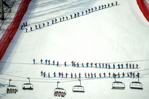 KRASNAYA POLYANA, RUSSIA  - JANUARY 16: Volunteers ski down the mountain after the Men's Super-G at at Rosa Khutor Alpine Center during the 2014 Sochi Olympics Sunday February 16, 2014.  (Photo by Chris Detrick/The Salt Lake Tribune)