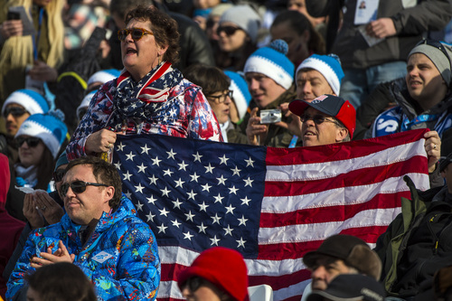 KRASNAYA POLYANA, RUSSIA  - JANUARY 16: Fans cheer for Bode Miller as he competes in the Men's Super-G at at Rosa Khutor Alpine Center during the 2014 Sochi Olympics Sunday February 16, 2014. Miller tied for the bronze medal with Canada's Jan Hudec. Both had a time of 1:18.67. (Photo by Chris Detrick/The Salt Lake Tribune)